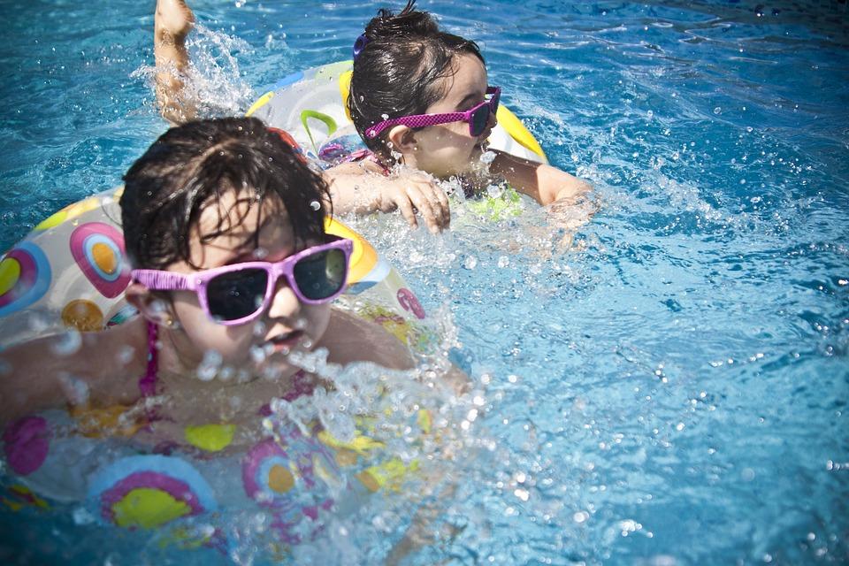 girls swimming in pool splash fun