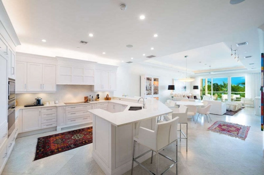 photo of open concept white kitchen to living room
