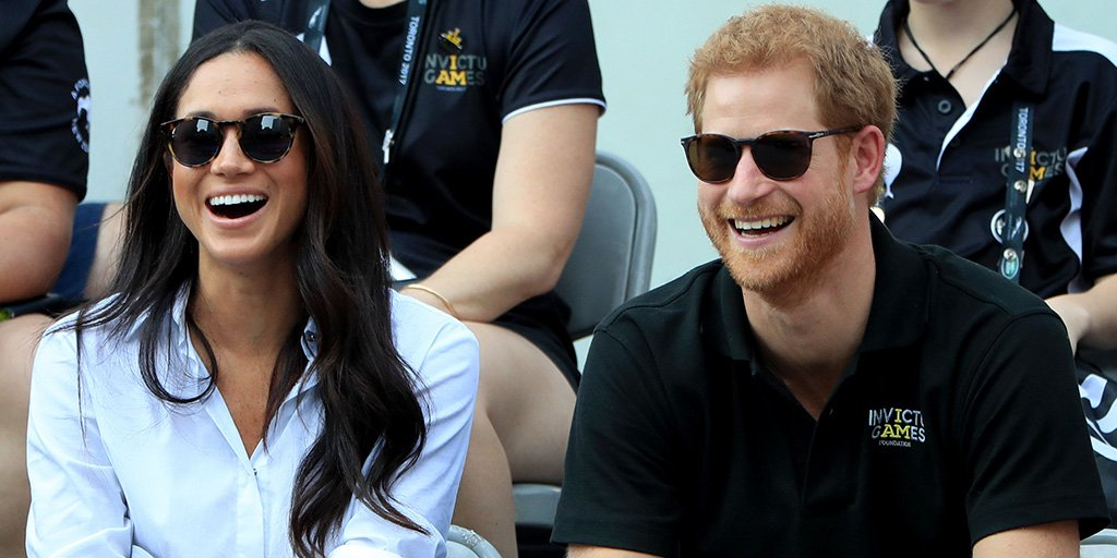candid photo of harry and meghan