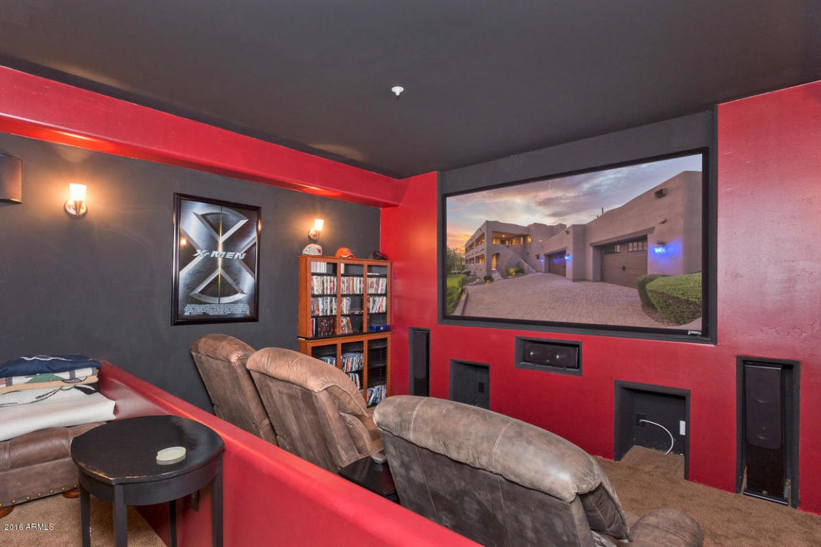 in home theater with red walls