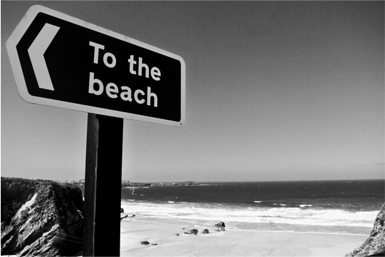 black and white photo of the beach
