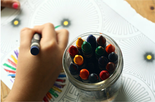 child's hand coloring