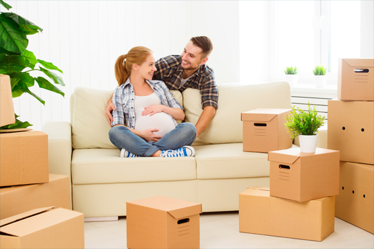 pregnant wife moving boxes