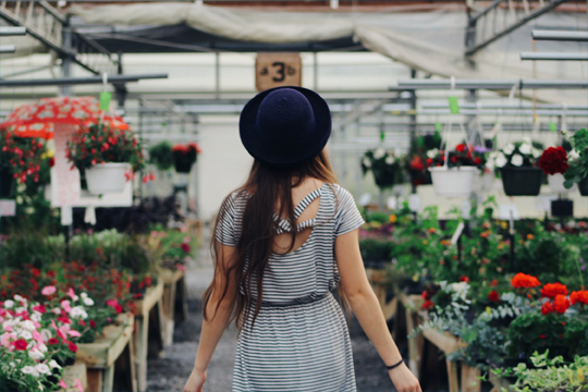woman walking in garden nursery