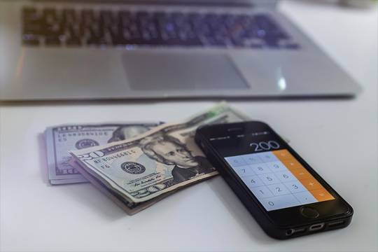 us dollars and calculator on phone