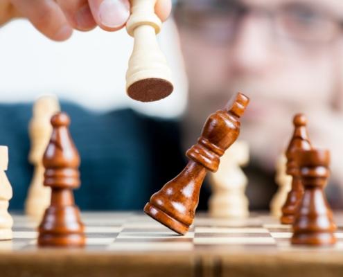man playing chess strategy