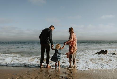 Family on beach for spring break