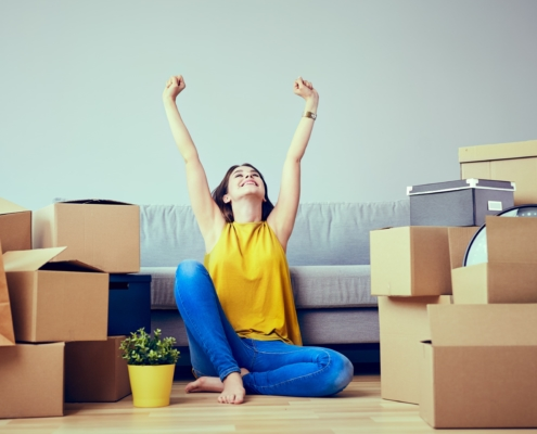 woman happy moving boxes