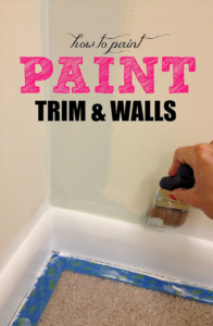 Hand with a paintbrush painting a wall white