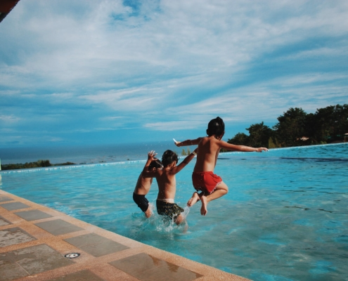kids jumping into pool header image